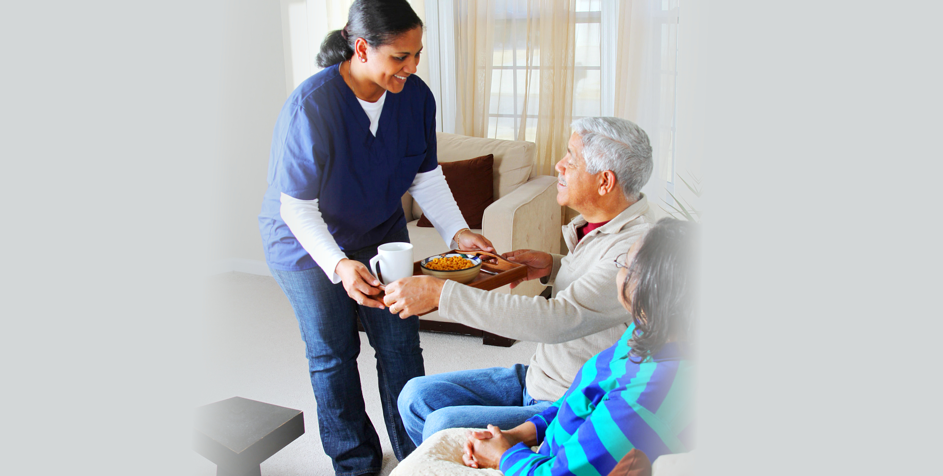 woman giving food to a senior