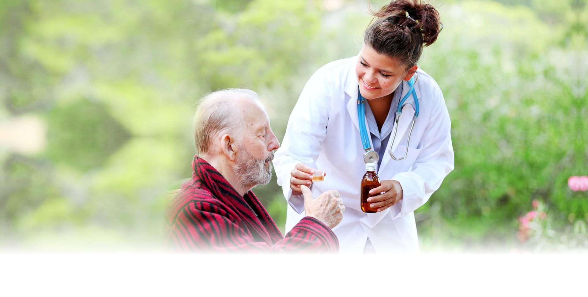 woman giving medicine to a senior