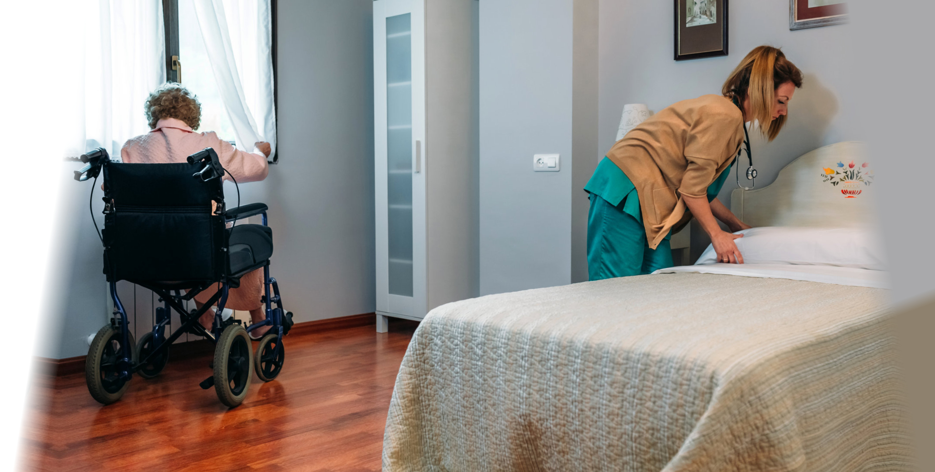 Caregiver making the bed of an elderly patient in a nursing home