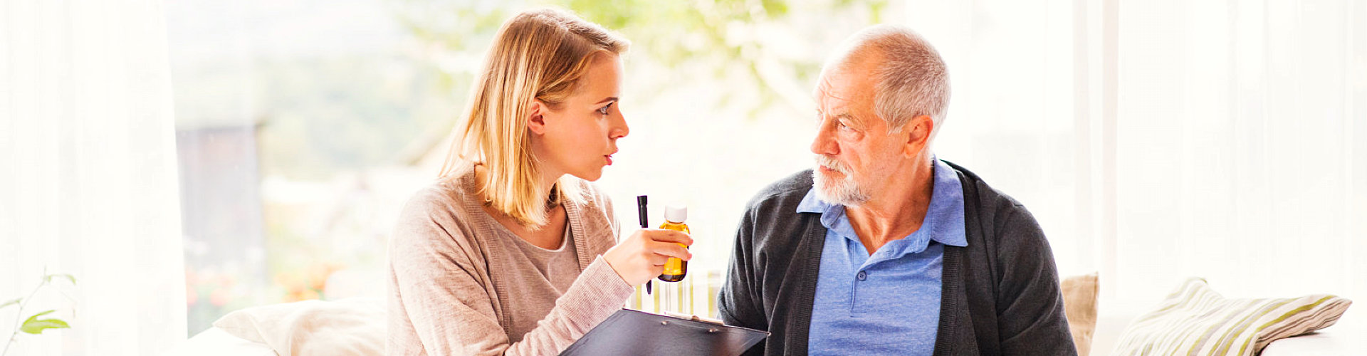 caregiver and old man talking