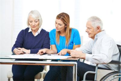 speech therapist helping two seniors