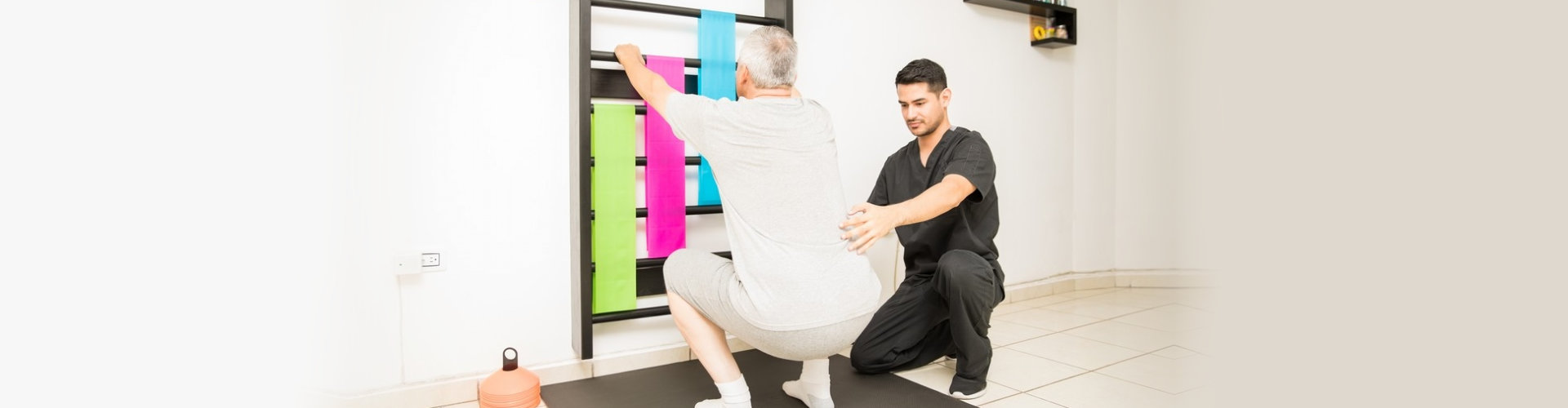 physical therapist helping a senior man